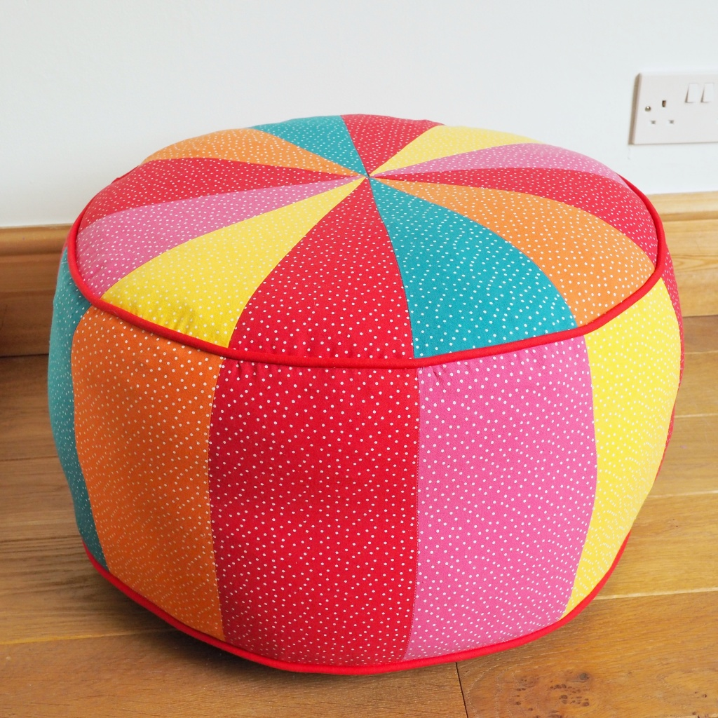 A rainbow coloured pouf