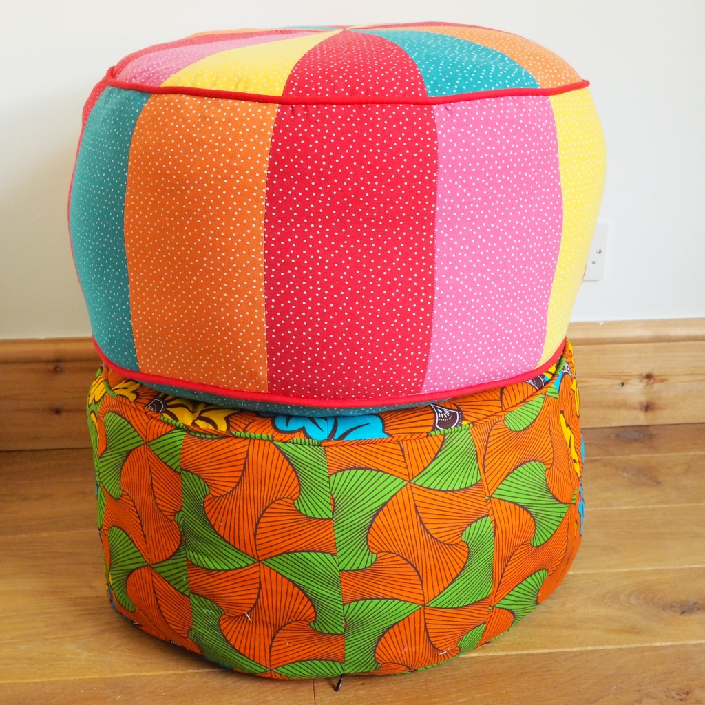 A pile of two poufs on top of each other